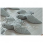 Craved granite doves