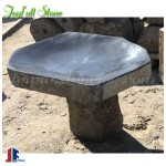 Basalt birdbath for garden and landscaping