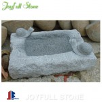 Carved stone birdbath for garden and landscape