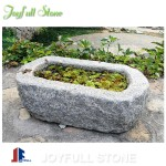 Old stone trough planters