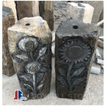 Black basalt pillar water fountain with flower carvings