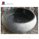 Round stone sinks with rough rustic surface