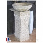 Yellow granite pedestal sink and basin